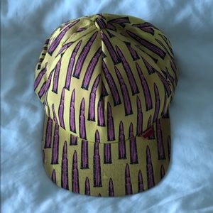 Supreme SnapBack yellow cap with pink bullets.